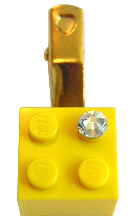 Yellow LEGO (R) brick 2x2 with a Diamond color SWAROVSKI crystal on a Silver/Gold plated hair clip (one piece)
