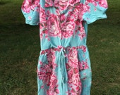 50s floral day dress with zip front and bow.