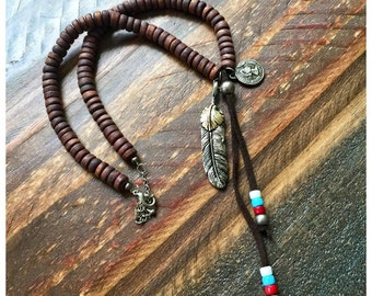 Tribal feathered necklace with wooden beads