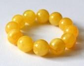 Amber bracelet 17,8 mm butterscotch color antique Baltic amber round bead bracelet, egg yolk color