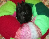 plump Ugli Donut rabbit bed for a small sized bunny hand knit