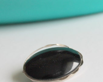 oval black silver brooch