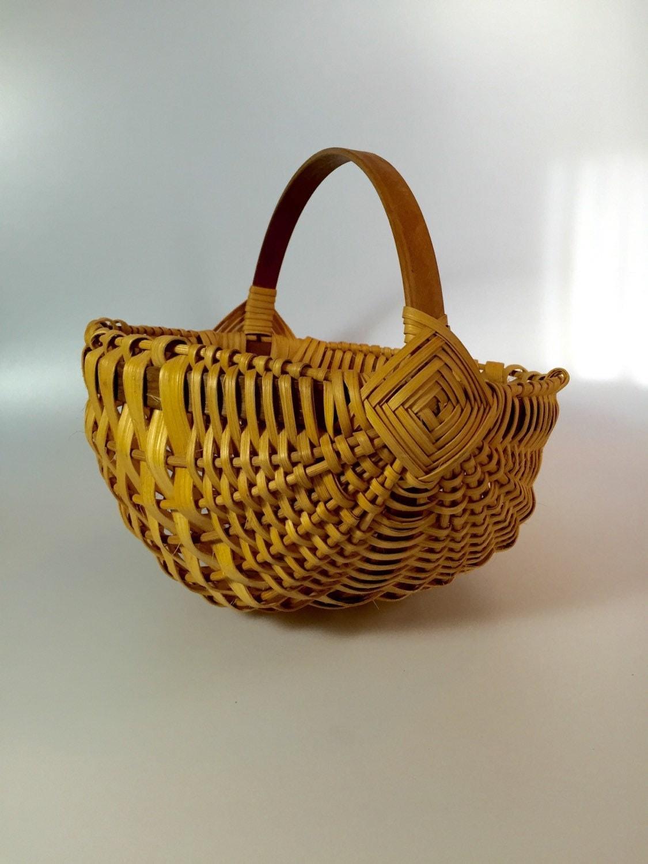 Woven Gathering Basket : Hand woven signed gathering basket