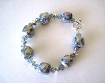 Bracelet.  blue ceramic beads