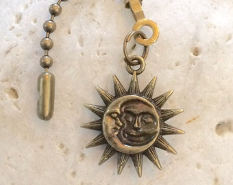 Double sided Celestial sun and moon light pull, ceiling fan pull. Bronze decorative ball chain pull.