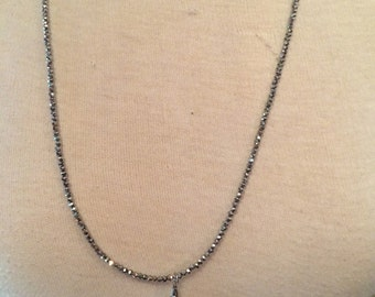 Beautiful sparkly hematite beaded necklace with grey silk tassel charm pendant
