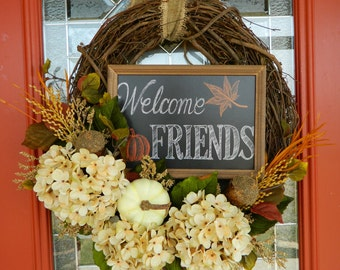 Elegant Fall wreath with welcoming chalkboard sign!