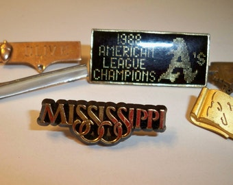 """Six Collectible Vintage Pins,""""American League Champion  A's  1988, """"Mississippi,"""" Gold """"Olive,"""" Mother of Pearl Bar, """"SC"""", Gold 100 Scroll"""""""