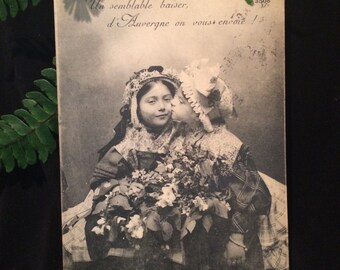 French Real Photo Postcard - Girls with Flowers - Kiss on the Cheek -Antique Photo
