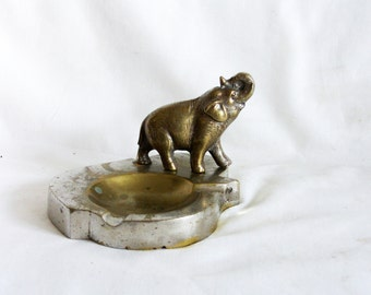 Robust solid brass elephant on vintage ashtray, heavy. Raised trunk, ash tray. Silver & golden hue. Safari, animal, home decor, old, display