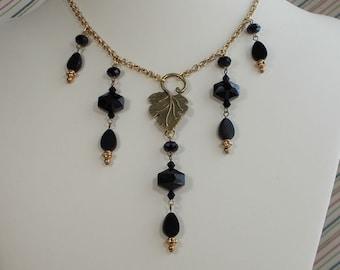 Jet Black Glass and Antiqued Gold Finiish Bib Necklace  0436