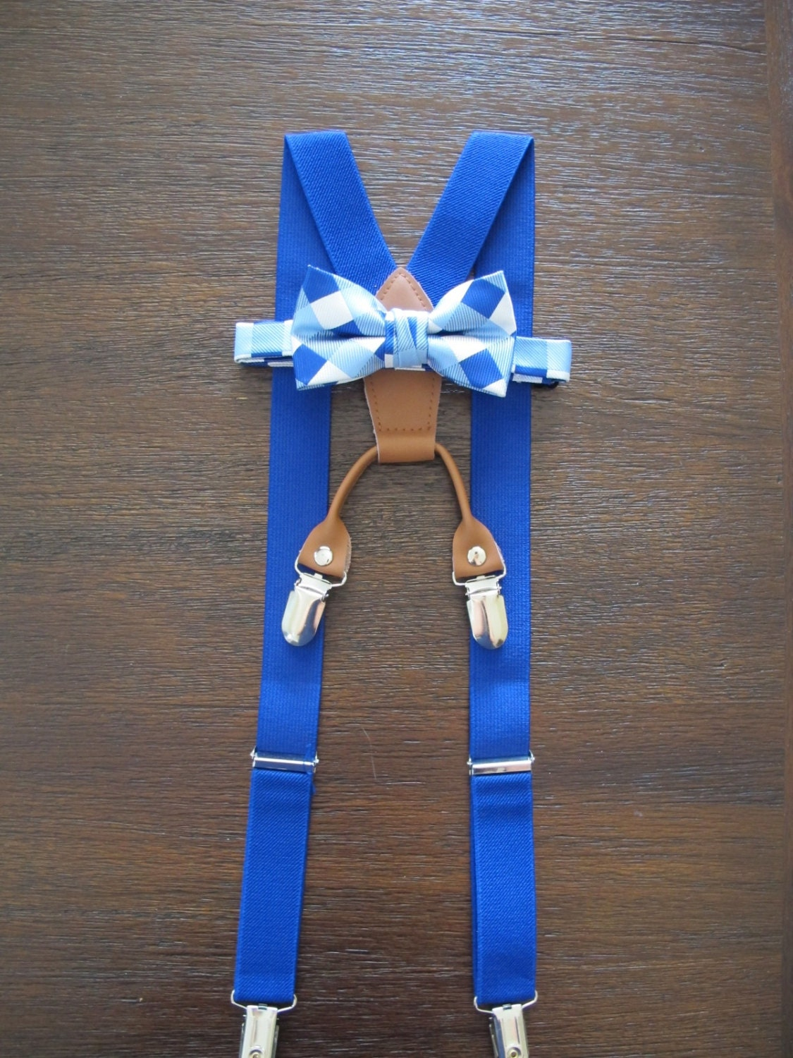 Bow tie and suspenders set are made out of % high quality cotton fabric and are hand/machine sewn. The suspender straps are adjustable with a slider and easy to use suspender clips (4) with plastic grip teeth to protect material from damage.