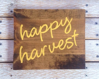 Happy Harvest sign hand painted on reclaimed wood