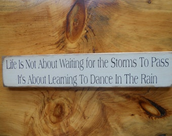 Life Is Not Waiting For The Storms To Pass It Is About Learning To Dance In The Rain  Wood Sign