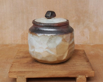 Small faceted wood fired keepsake jar with shino glaze