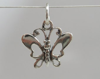 solid 925 sterling silver butterfly charm, pendant with ring. Wholesale. Shiny. 17 mm by 16 mm by 1.85 mm. CP03