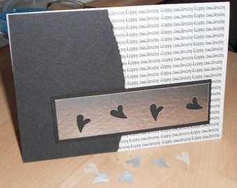 Anniversary black & silver handmade card.  Punched silver hearts/confetti design, handcrafted/designed in UK. A6 card...