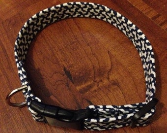Dog collar with blue and white bones made from 100% cotton fabric with strong webbing core and acrylic push fit buckle