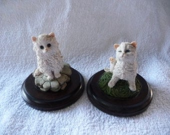 a pair of Country Artists Cats