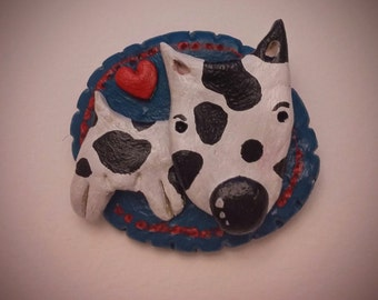 Quirky and bright, handmade and painted air-dry clay spotty dog with a love heart brooch.