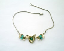 Pretty delicate vintage goldtone flowers choker necklace with green rhinestones
