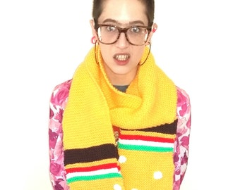 Burger scarf. Hand knitted yellow scarf with polka dot detail