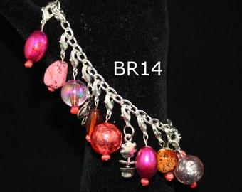 pink charm bracelet; silver charm bracelet; interchangable charm bracelet; charm bracelet; glass charm bracelet; nugget charm bracelet