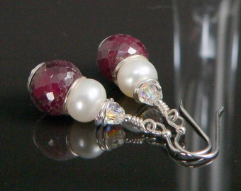 Faceted Rubies, Freshwater Pearls and Swarovski Crystals with Sterling Silver Findings.