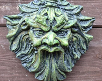 Demon green man garden wall plaque frost proof stone