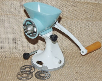 Spong Basildon Essex 605 model steel and plastic hand mincer meat grinder with 3 spare blades made early 1970s
