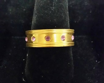 Goldtone ring with pink accents