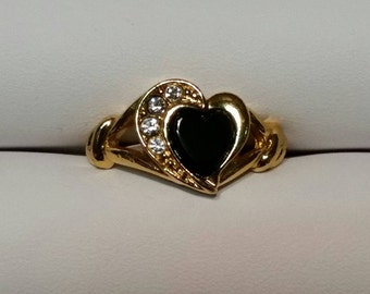 Goldtone Avon ring with black heart shaped stone and accents