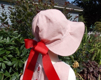 Handmade, adjustable little girl's Ribbon Sun Hat made from vintage fabric and grosgrain ribbon.