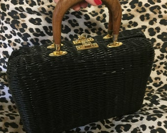 It's in the bag! Vintage black coated wicker Ritter brand bag with wooden handles