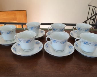 Set of 7 cups and saucers