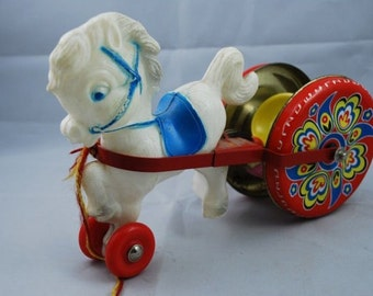 1950s PULL ALONG HORSE, Metal wheels and plastic horse, cute!