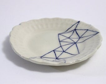 blue and white geometric patterned plate