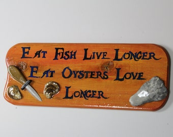 Eat Oysters Love Longer - Handpainted cypress wood sign with handcarved oyster shucker and real oyster shells with high gloss finish.