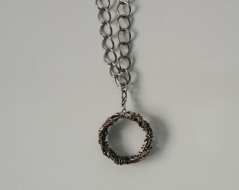 Wire ring on silver colored chain