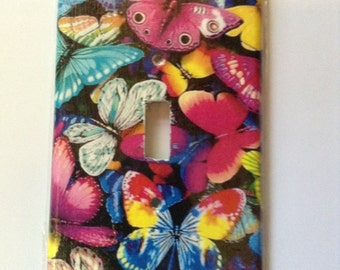 1 wall switch plate cover.   Butterfly, unicorn,