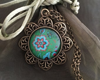 Cabochon flower with antique bronze setting