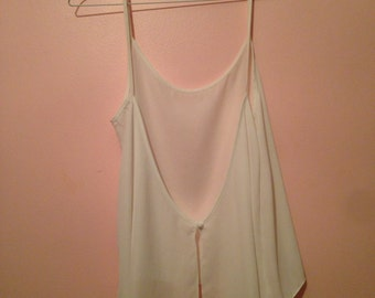 Sleeveless sheer white open back top with button closure