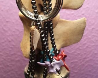 Painted Rattle Snake Vertebra Beaded Keychain