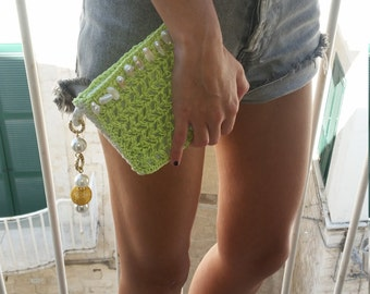 Green and white lined clutch bag, crochet with beads and cord