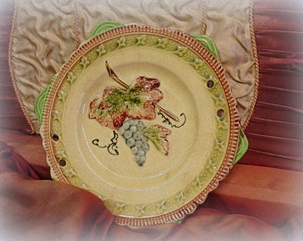 vintage majolica plate marked JAPAN unUsual color combination dimensional grapes holes for handle