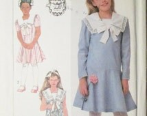 1980s Vintage Sewing Pattern Simplicity 7975 Girls Pullover Dress Pattern Size 7, 8, 10 Uncut