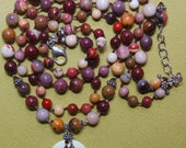 Hand knotted natural moukaite, lemon chrysophase, Swarovski crystal and Bali sterling silver beaded necklace.