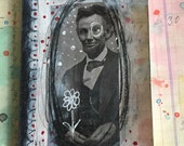Altered handmade notebook with hand colored paper and image transfer, I know not Lincoln