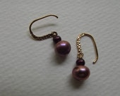 E 541  Earrings with orchid and cherry pearls.