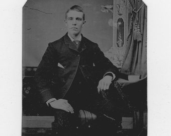 1800s vintage tin type photo of a well dressed man